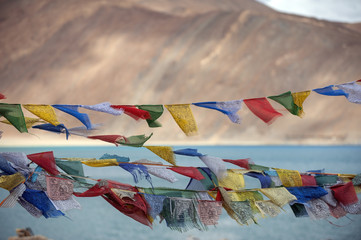 Flag againt blue lake in ladakh India