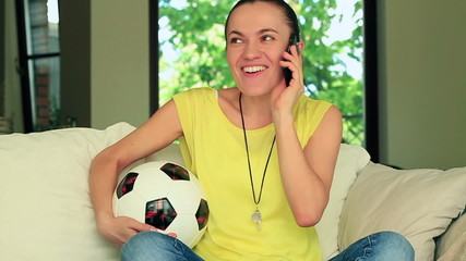 Female football fan talking on the phone, slow motion