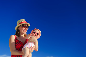 mother and baby on beach vacation