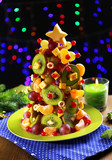 Fruit Christmas tree on table on dark background