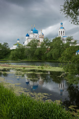 White church with blue domes and scenic clouds, Bogolubovo, Russ