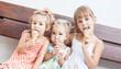 funny children girls eating ice cream - 64954726