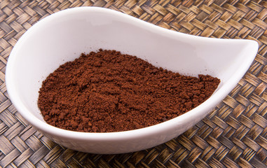 Instant coffee powder in ceramic container