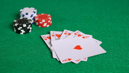Royal Flush Poker Hand on Table with Chips