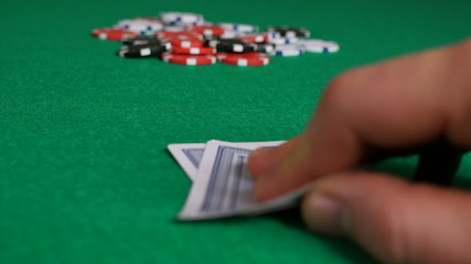 Poker Player with Pocket Aces Considering His Move