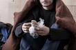 Homeless man eating sandwich