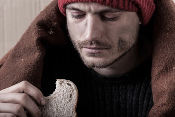 Homeless and poor man eating sandwich