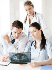group of doctors looking at x-ray
