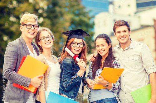 students or teenagers with files and diploma - 64959171