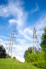 Electrification towers on the green hill
