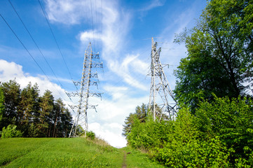 Electrification towers on the green hill horizontal