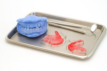 Dental gypsum models and dental brace (Retainer) in medical tray
