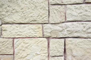Stony wall with uneven structure