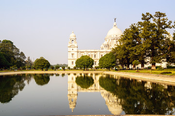 Victoria Memorial reflected in lake. Kolkata