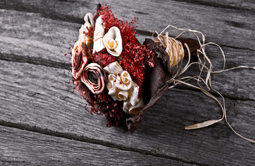 antique dry flower wedding bouquet on grunge wood