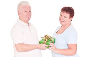 senior women gives gift to man