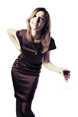 Fashion young woman with a red wine glass