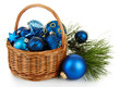 Christmas decorations in basket and pine branches isolated