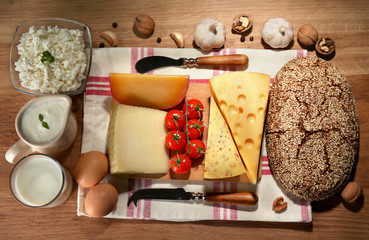Still life with dairy products and bread on wooden table