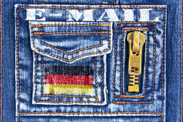 Denim material with a pocket in the form of German mailbox.