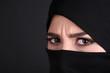 Beautiful muslim arabic woman in paranja on dark background
