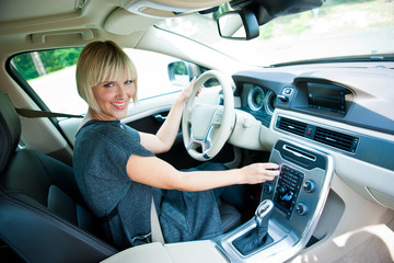attractive woman driver in her car