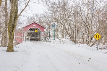 Covered Bridge in Quebec during a Snowfall
