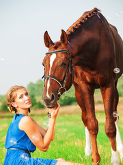 young beautiful  girl  with her horse