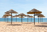 Blue sky, blue sea and parasols at  beach in Portugal
