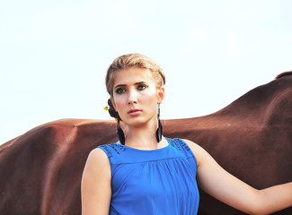 young beautiful serious  girl  with  horse