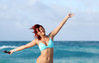 Cute young redhead woman smile and enjoy sun on the ocean shore