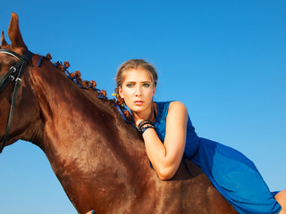 young beautiful serious  girl  ride on horse