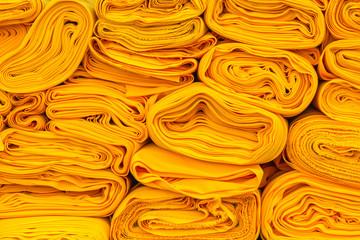 cloth rolls of yellow robe