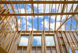 New construction home framing against sky - 64972724