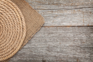 Ship rope on wood and burlap