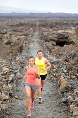 Cross country running woman and man trail runners