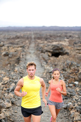 Trail running man and woman cross country runners