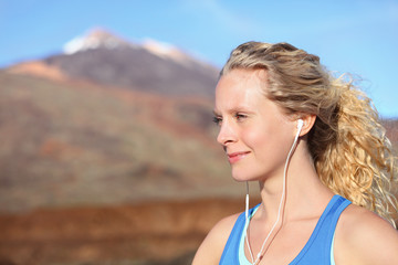 Earphones - woman runner listening to music