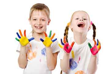 happy smiling children showing their hands painted in bright col