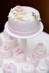 Delicious pink wedding cake and cupcakes
