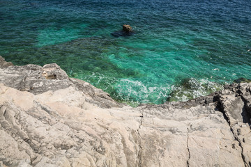 Rocky beach in Pula, Croatia, Adriatic sea.
