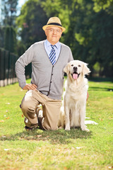 Senior gentleman posing in the park with a dog