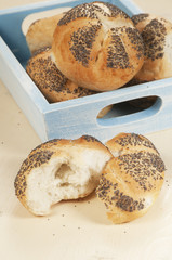Buns with poppy seeds in a box
