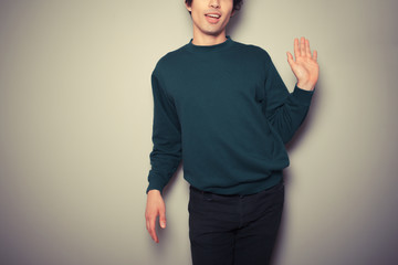 Young gay man is waving