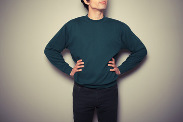 Young man standing in a powerful pose