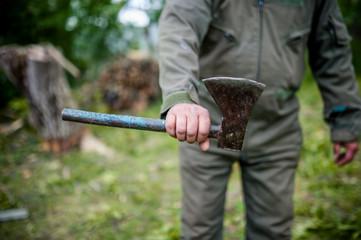 Dangerous man holding an custom made steel, sharp ax