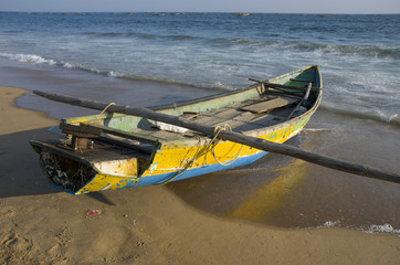 wooden fishing boat on Bengal sea  beach  in Tamilnadu, India