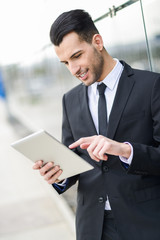 Businessman with tablet computer in office building