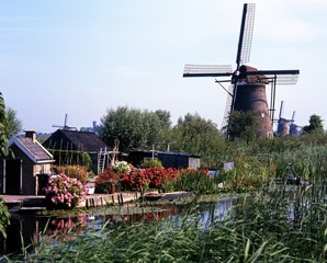 Windmills along waterway, Kinderdijk, Holland © Arena Photo UK