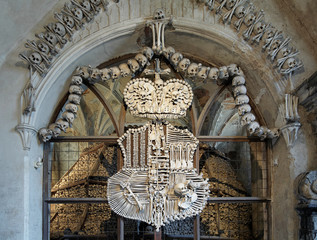 Coat-of-arms made with bones in Sedlec ossuary, Czech Republic